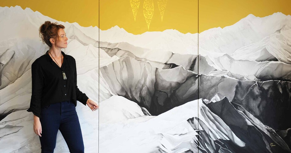 "Artist Sofia Minson with her 3 metre wide painting ""Te Waka a Māui"" looking out over the Southern Alps"
